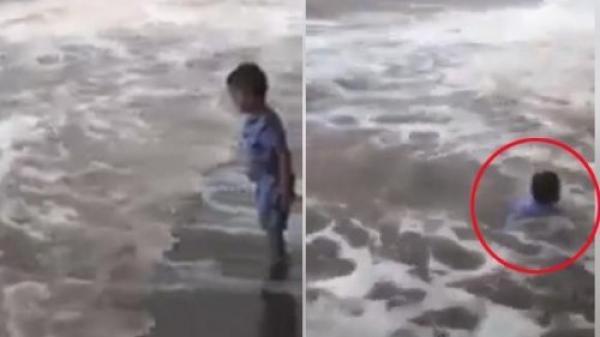 Quất Lâm (Nam Định): Bé trai hồn nhiên chơi đùa dưới sóng dữ, suýt bị cuốn ra biển trong ngày mưa bão