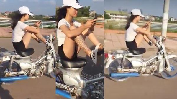 Rợn người: Clip nữ sinh điều khiển xe máy bằng chân, tay chơi điện thoại
