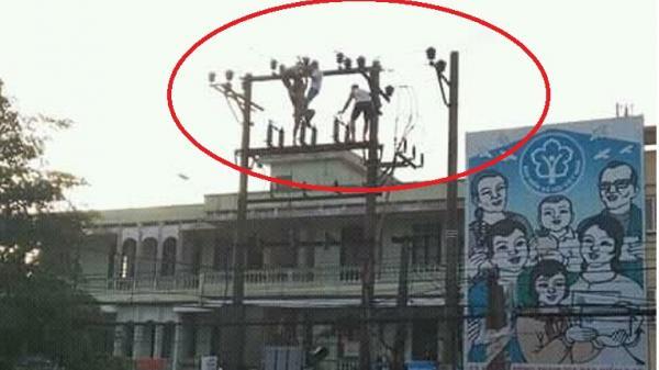 Nghẹt thở màn giải cứu người đàn ông trèo lên trạm điện biến áp tự tử ở Nam Định