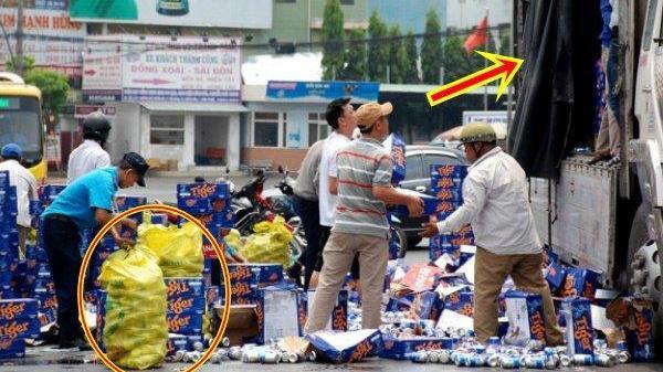 Người dân giúp tài xế thu gom hàng trăm thùng bia