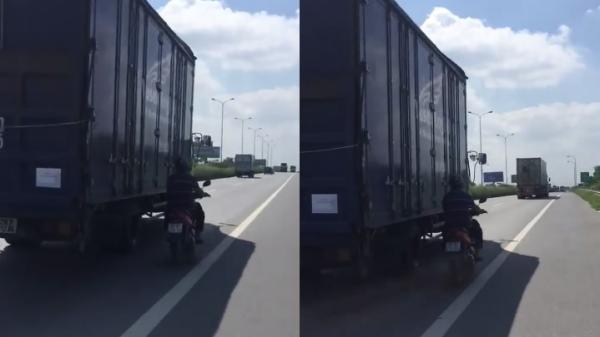 Chiêu độc: Liều mạng chạy song song container để tránh nắng trên cao tốc Hà Nội - Bắc Giang