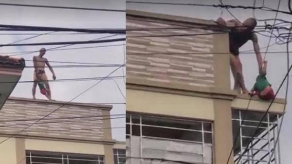 Video: Thanh niên xăm trổ ôm bé trai lên nóc nhà cố thủ khiến nhiều người hoảng sợ
