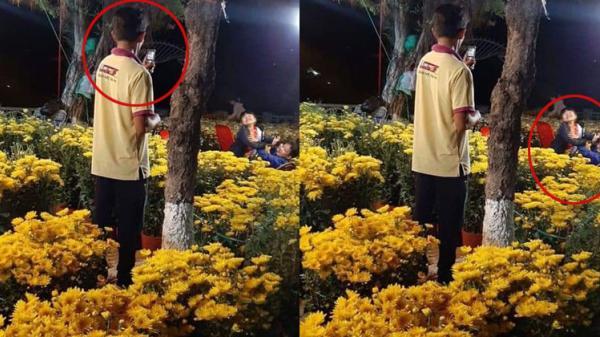 Xúc động hình ảnh người cha dùng điện thoại 'cùi bắp' chụp ảnh cho hai con giữa vườn hoa xuân