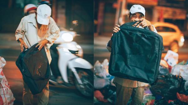Người đàn ông lam lũ và nụ cười khi nhặt được chiếc túi còn lành lặn trong đống rác ven đường