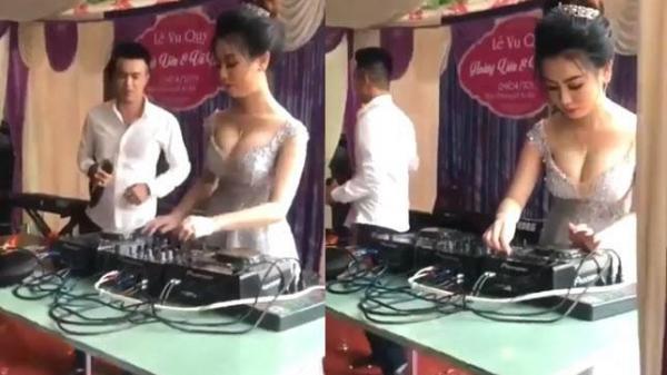 Clip cô dâu xinh siêu vòng 1 trổ tài làm DJ trong đám cưới khiến người xem không chớp mắt