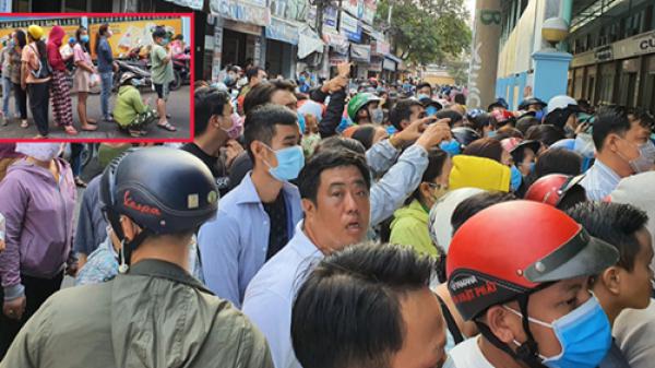 Hàng trăm người dân TP.HCM bỏ ngày chủ nhật xếp hàng dài từ sáng sớm chờ mua khẩu trang y tế