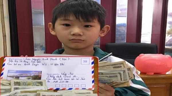 Bé 8 tuổi 'đập lợn' góp tiền chống Covid-19