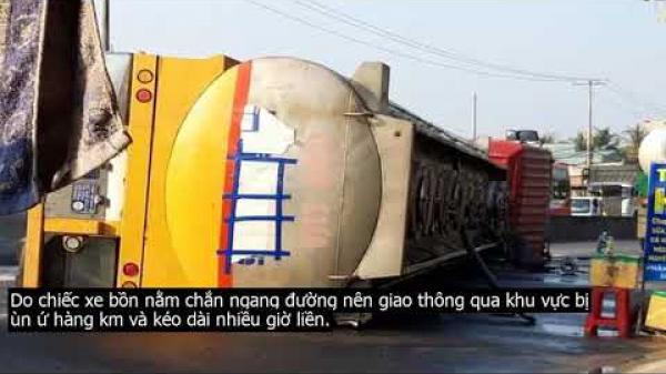 Tiền Giang: Xe bồn lật ngang tràn chất lạ ra đường, giao thông ùn hàng km