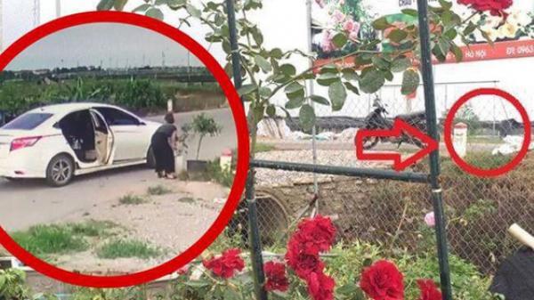 """Mê Linh: Clip để hoa ở cổng chưa kịp giao cho khách 5 phút sau đã bị người phụ nữ đi ô tô qua """"cầm giùm"""""""
