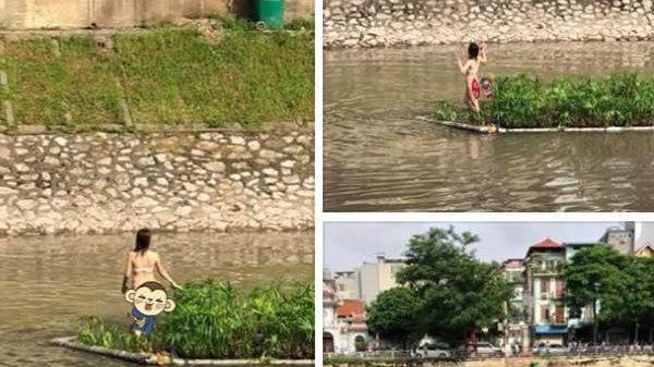 Cô gái ngang nhiên cởi đồ bơi ra giữa sông nhảy nhót