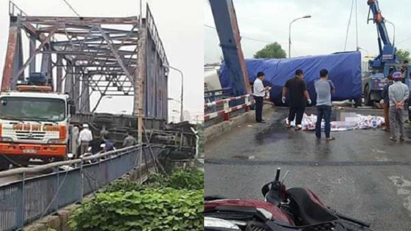 Xe tải lật chắn ngang cầu, đè tử vong một phụ nữ đi xe máy