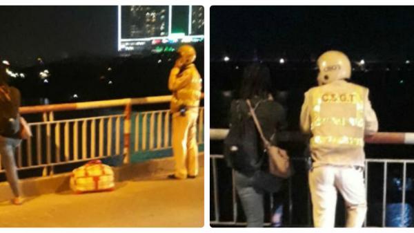 Công an đứng nói chuyện 30 phút với người phụ nữ dí kéo vào cổ đòi nhảy sông tự t.ử