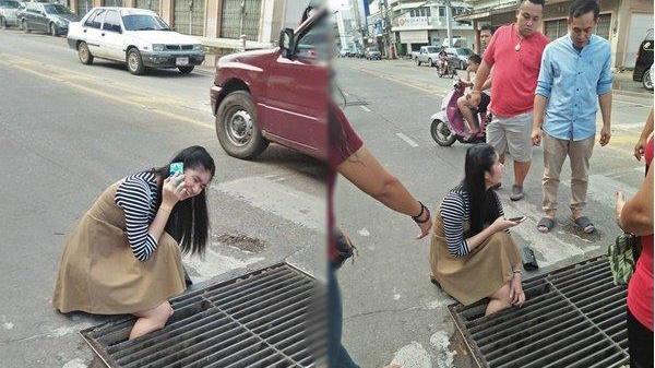 Lọt chân xuống cống vẫn tiếp tục nói chuyện điện thoại, cô gái khóc ròng khi lôi chân lên thấy cảnh tượng này