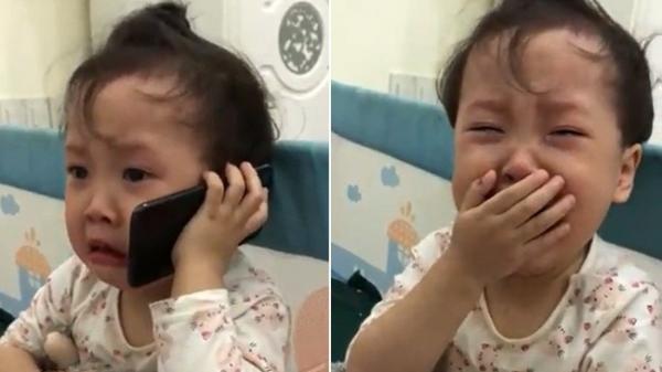 Cô bé 3 tuổi khóc nức nở gọi cho ông vì bị cha trêu không ngủ được