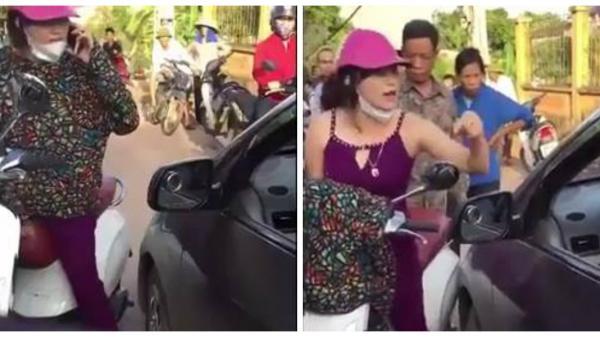 """""""Nữ ninja"""" đứng giữa đường nghe điện thoại, bị ôtô tông liền chửi như """"tát nước"""", gọi """"500 anh em"""" tới quyết chiến"""
