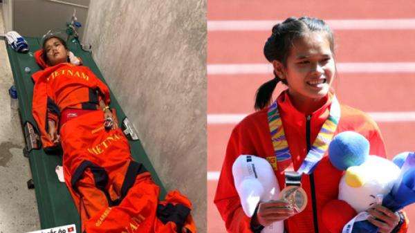 Hình ảnh nữ vận động viên Việt Nam k.iệ.t s.ứ.c, không thể tự mặc quần dài lên nhận huy chương tại SEA Games 30