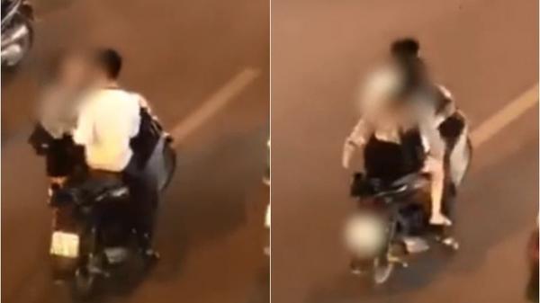Video: Đôi nam nữ gây bức xúc khi không đội mũ bảo hiểm, dừng xe máy giữa đường phố để... cãi nhau