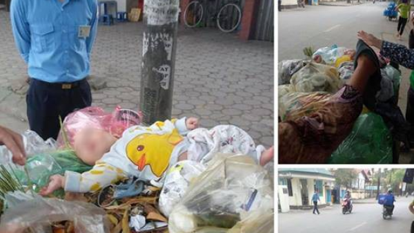 """Cảm thương bé trai kháu khỉnh bị người thân """"bỏ quên"""" trên thùng rác giữa phố"""