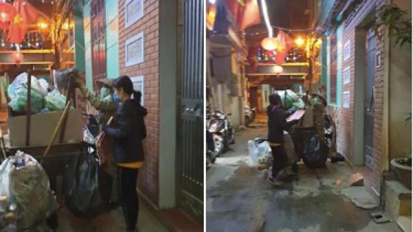 Cô con gái phụ mẹ đẩy chiếc xe rác cao ngất trong đêm 30 khiến nhiều người xúc động