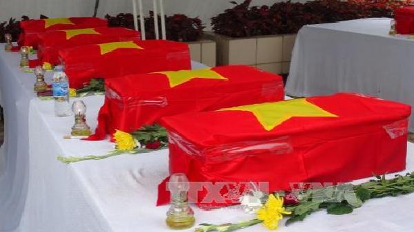 Lễ tiếp nhận, an táng hài cốt liệt sĩ Việt Nam hy sinh tại Lào