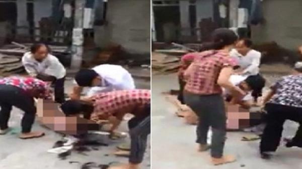 5 người lột đồ, cắt tóc phụ nữ giữa đường, xử tội gì?