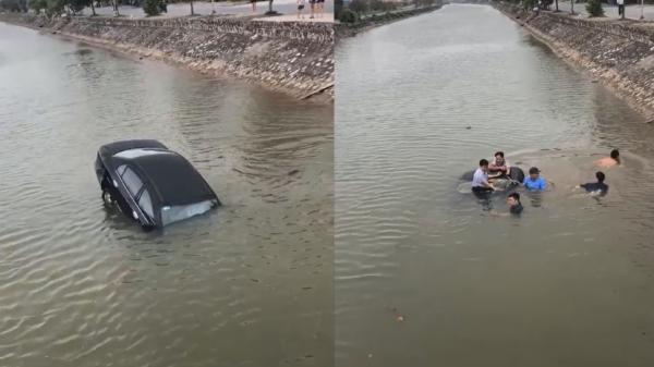 Clip: Ô tô mất lái rơi xuống sông, người dân hợp sức đ.ập kính giải cứu tài xế
