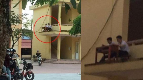 Quá nóng, 2 nam sinh mang bàn ghế ra ngoài lan can để hóng gió học bài khiến ai cũng choáng