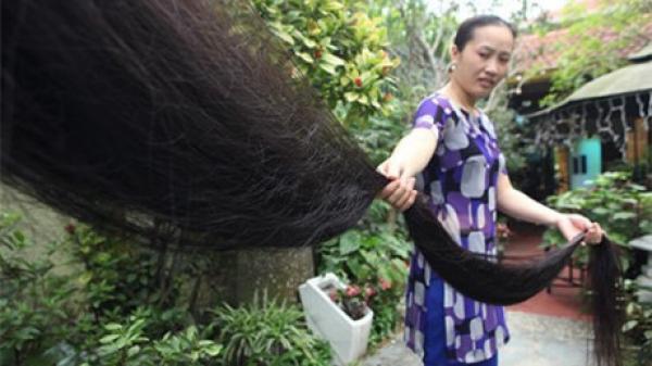 Chiêm ngưỡng mái tóc dài nhất Việt Nam đen óng mượt mà tại Thái Bình