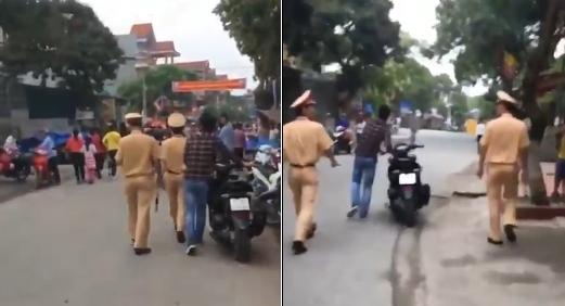 Nam thanh niên đi hội không mũ được 2 chiến sĩ CSGT hộ tống dắt xe suốt chặng đường dài