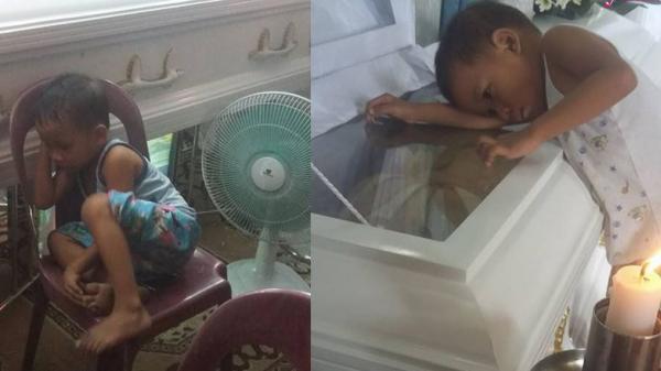 Hình ảnh bé trai bơ vơ ôm quan tài mẹ khiến triệu trái tim quặn đau