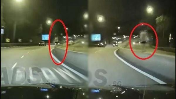 Anh lái xe về nhà lúc nửa đêm nhìn thấy cô gái mặc váy trắng đứng trên thanh chắn, khi xem lại camera hành trình liền lạnh sống lưng
