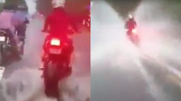 """Clip: Thanh niên phóng xe PKL tốc độ cao giữa lúc mưa ngập khiến người đi đường """"ướt như chuột lột"""""""