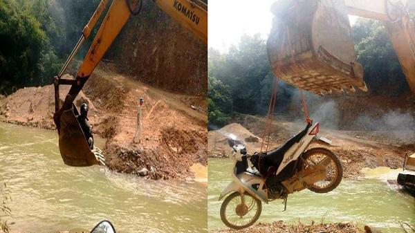 Thanh Hóa: Rùng mình cảnh người dân miền núi qua suối bằng máy múc
