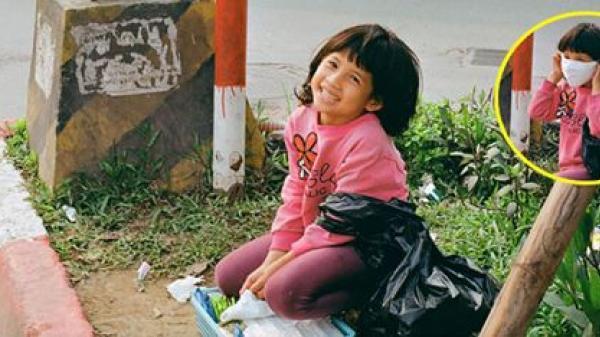Khoảnh khắc cô bé bán hàng rong nở nụ cười rạng rỡ khi được người lạ qua đường chụp hình 'hút' nghìn like