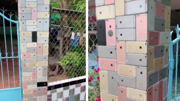 """Ngôi nhà xây hẳn chiếc cổng ốp lát toàn bộ bằng iPhone khiến cộng đồng mạng siêu tò mò """"dân chơi"""" này là ai"""