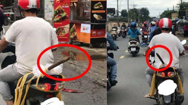"""Người đàn ông và thứ """"vũ khí nguy hiểm"""" ung dung di chuyển trên phố Sài Gòn khiến tất cả giật mình"""