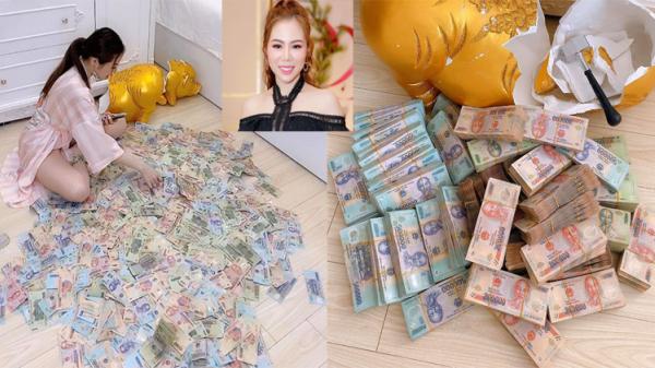 Tiết kiệm 11 tháng, đ ập lợn được gần 3 tỷ, cô gái trẻ khẳng định: 'Số tiền đó với tôi chẳng đáng là bao'