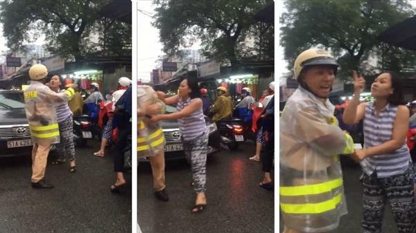 Người phụ nữ nắm cổ áo, lớn tiếng với CSGT ở Sài Gòn