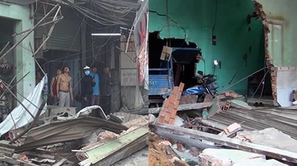 Giải cứu tài xế điều khiển container đâm sập nhiều nhà dân ở Bình Chánh
