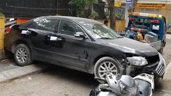 Đại tá công an cầm lái chiếc Toyota Camry chạy lùi cán chết người