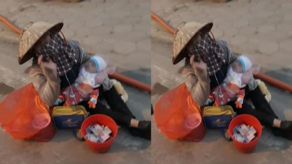 Vĩnh Phúc: Phẫn nộ hình ảnh người phụ nữ mang trẻ 3 tháng tuổi đi xin tiền giữa trời lạnh buốt