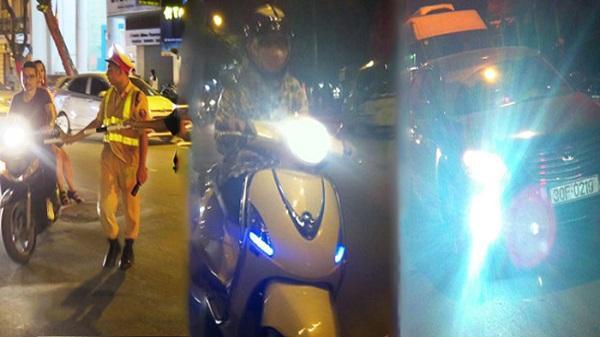 Phạt tới 800.000 đồng với người điều khiển phương tiện giao thông bật đèn pha trong khu đô thị buổi tối