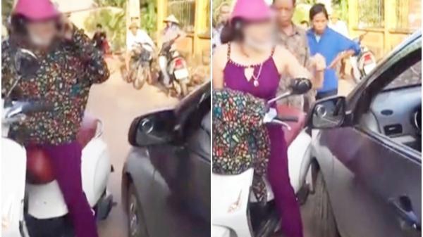 """Bị nhắc nhở khi đứng giữa đường nghe điện thoại, người phụ nữ chửi lái xe ô tô như """"tát nước"""" rồi xông vào đánh nhau"""