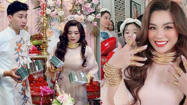 Cô dâu đeo vàng mỏi cổ và cầm tiền trĩu tay trong đám cưới, dân mạng được phen trầm trồ: Nhìn thôi cũng muốn cưới liền!