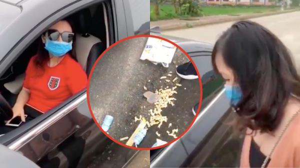 Bị nhắc nhở vì đỗ xe sai quy định và vứt rác xuống đường, nữ tài xế ngoan cố: 'Đường của nhà em à?'