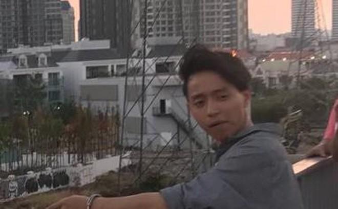 Quang bị bắt giữ trước đó. Ảnh: M.T