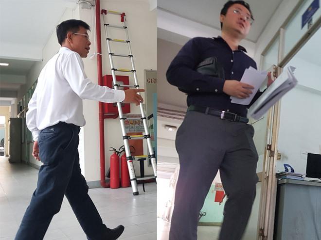 Ông Nguyễn Hải Nam (ảnh trái) và ông Lâm Hoàng Tùng đến trụ sở Công an Q.1 (TP.HCM) để làm việc với cơ quan điều tra ngày 25.9