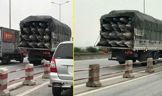 Chiếc xe tải mang BKS 99C – 059.61 chở nhiều bình nhiên liệu nghi của máy bay đi trên cầu Thanh Trì, Hà Nội. Ảnh: PV