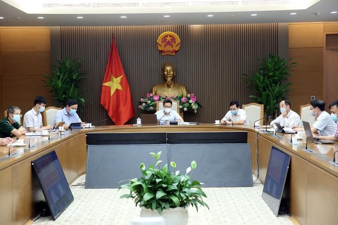 Phó Thủ tướng Vũ Đức Đam chủ trì cuộc họp trực tuyến với tỉnh Bình Dương sáng 30/6 (Ảnh: VGP).