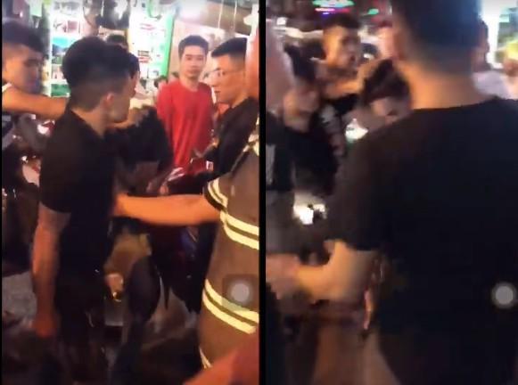 Nam thanh niên sửa điều hòa bị chồng của chủ nhà đánh tới tấp (Ảnh cắt từ clip)